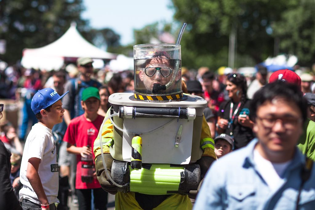 Man wearing a water tank helmet in a DIY diving suit at Maker Faire 2013.