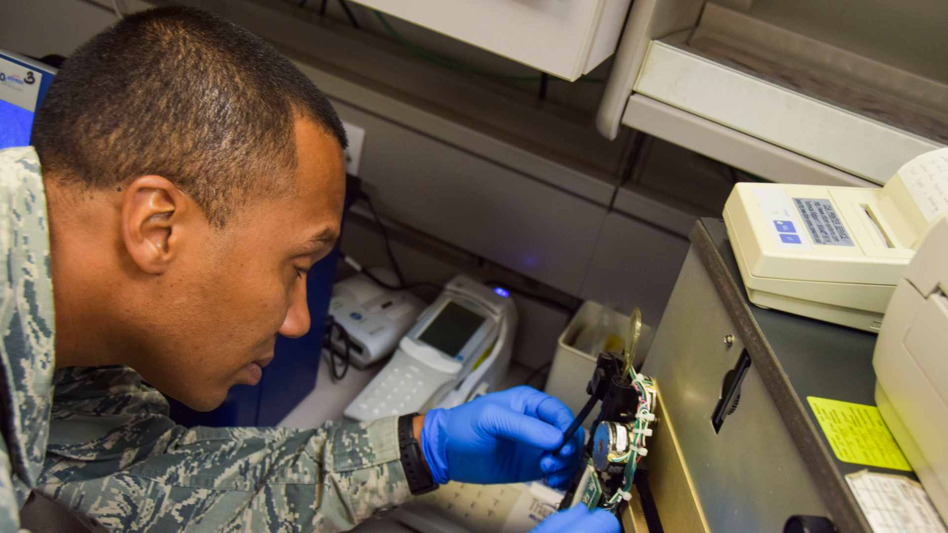US Air Force technical sergeant working on medical equipment.