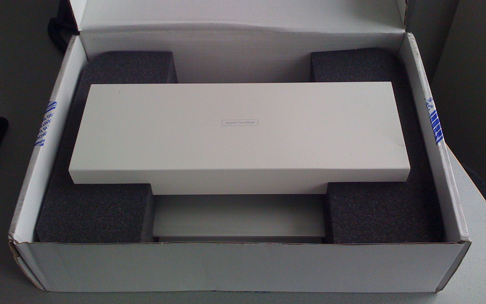 A refurbished MacBook Air in its packaging.