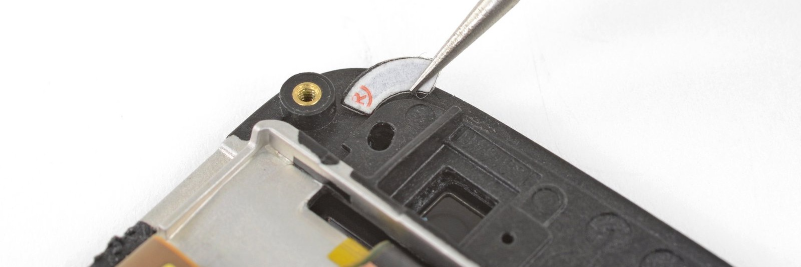 Applying a rounded Tesa Tape corner to a phone with tweezers