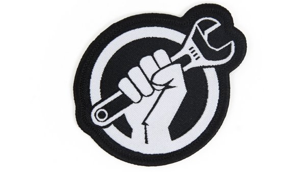 iFixit wrench logo on a canvas badge