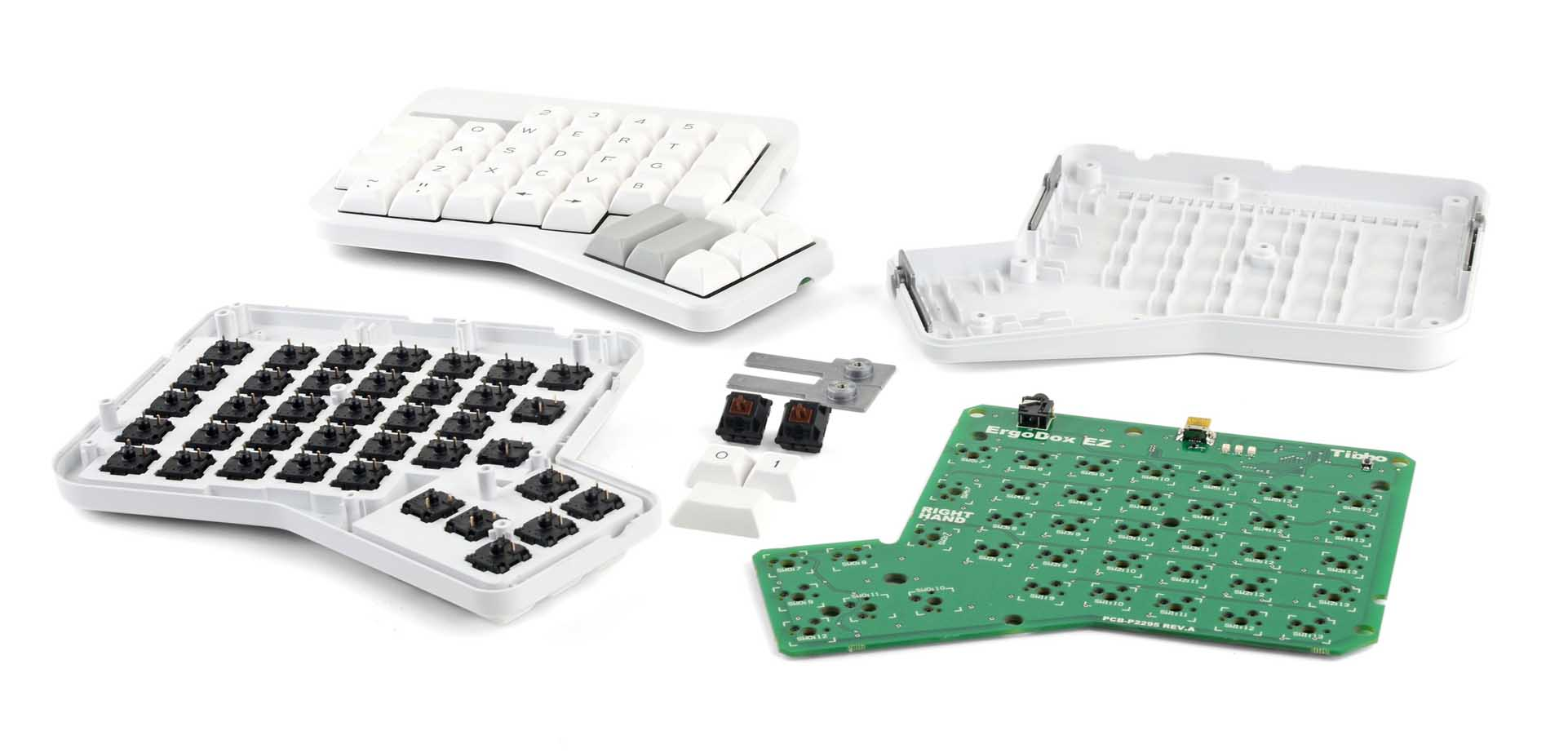 The ErgoDox EZ keyboard, torn down to its individual components.