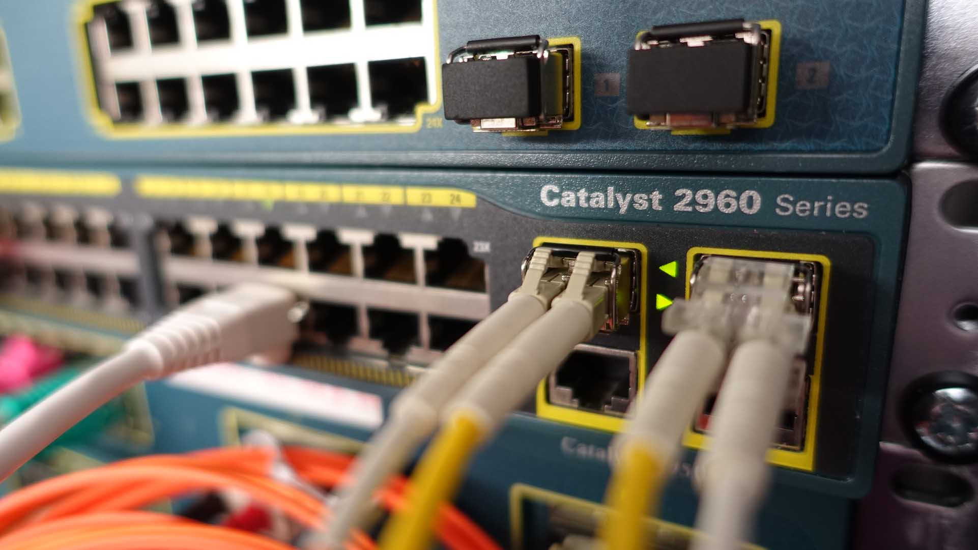 A Cisco Catalyst 2960 Series switch with cables plugged into it.