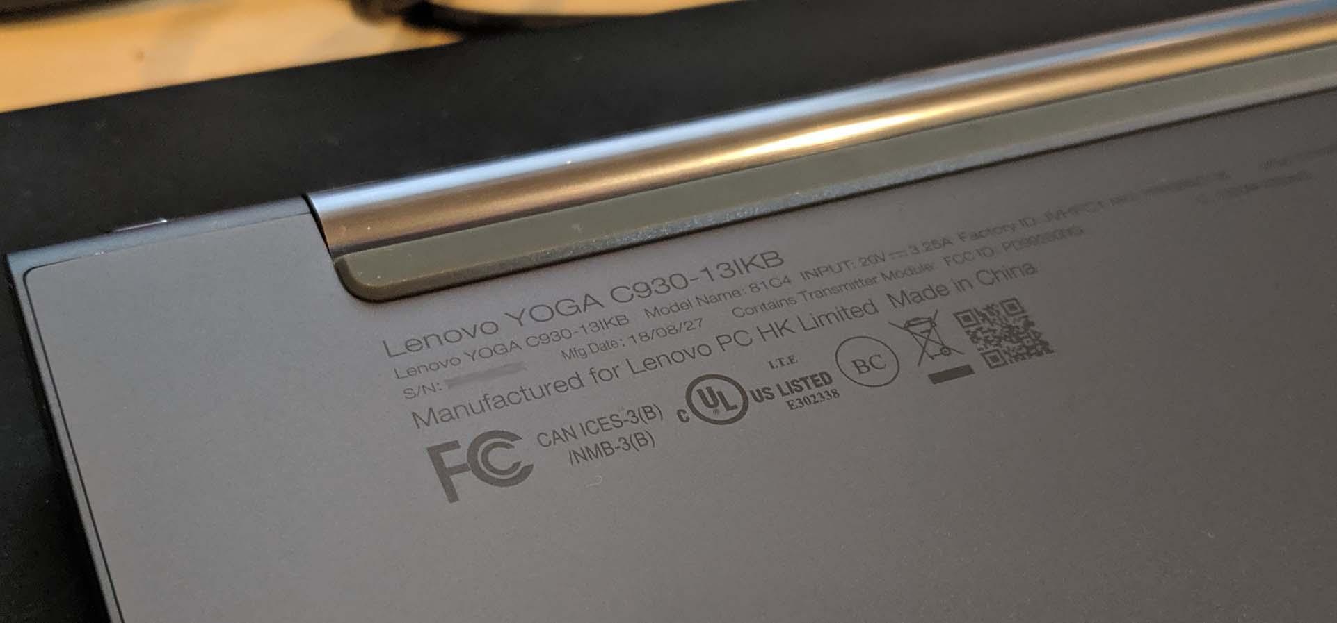 The bottom of a Lenovo Yoga laptop, showcasing its model number.