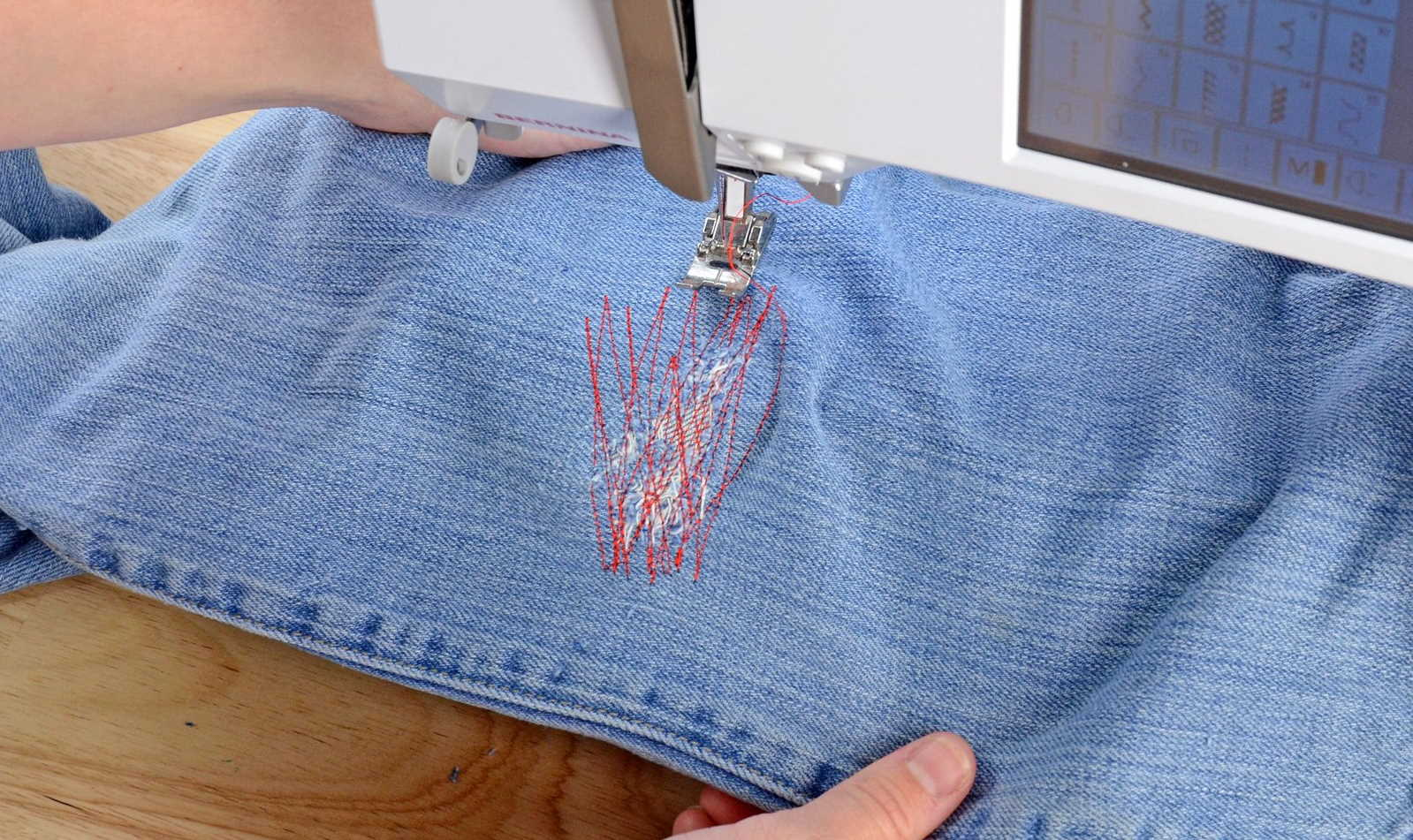 Zig-zag stitch on a hole in jeans