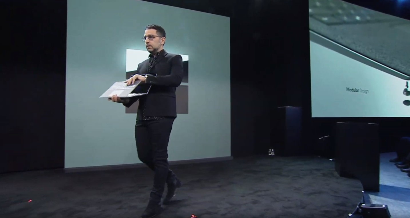 Microsoft executive opening a Surface Laptop 3 onstage