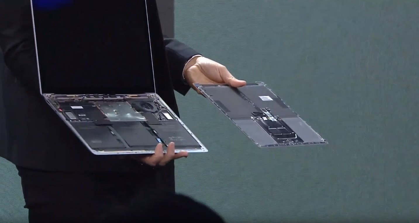 Microsoft executive with Surface Laptop 3 keyboard top removed.