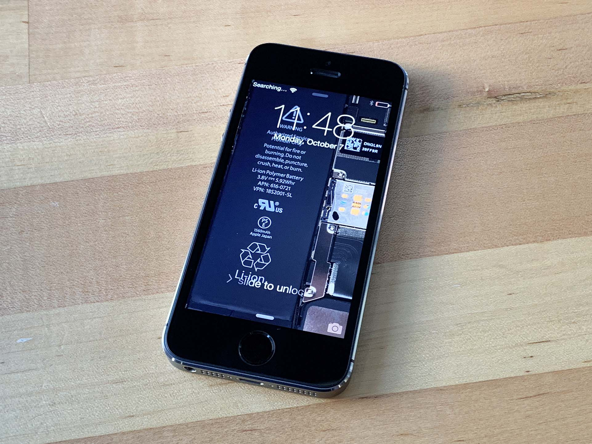 iPhone 5s teardown wallpaper in action