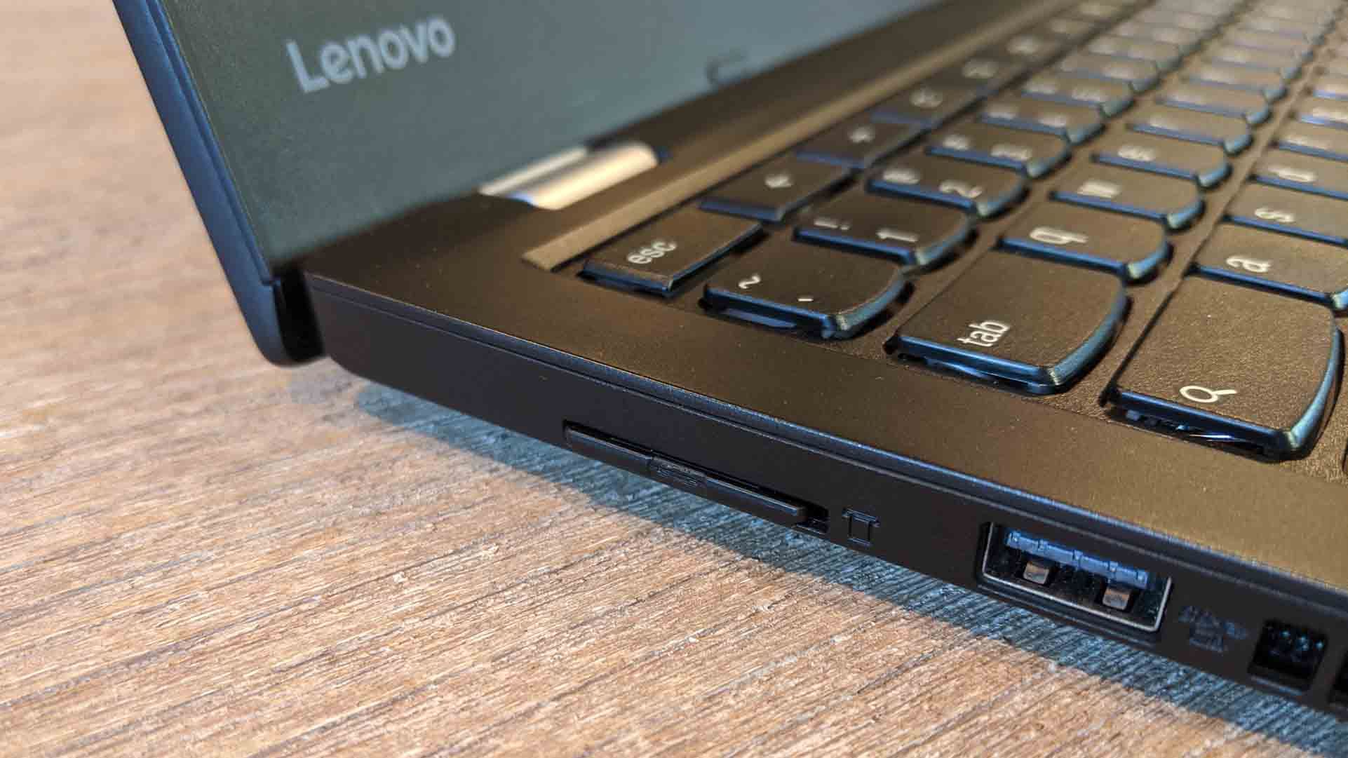 An SD card inserted into a Lenovo laptop.