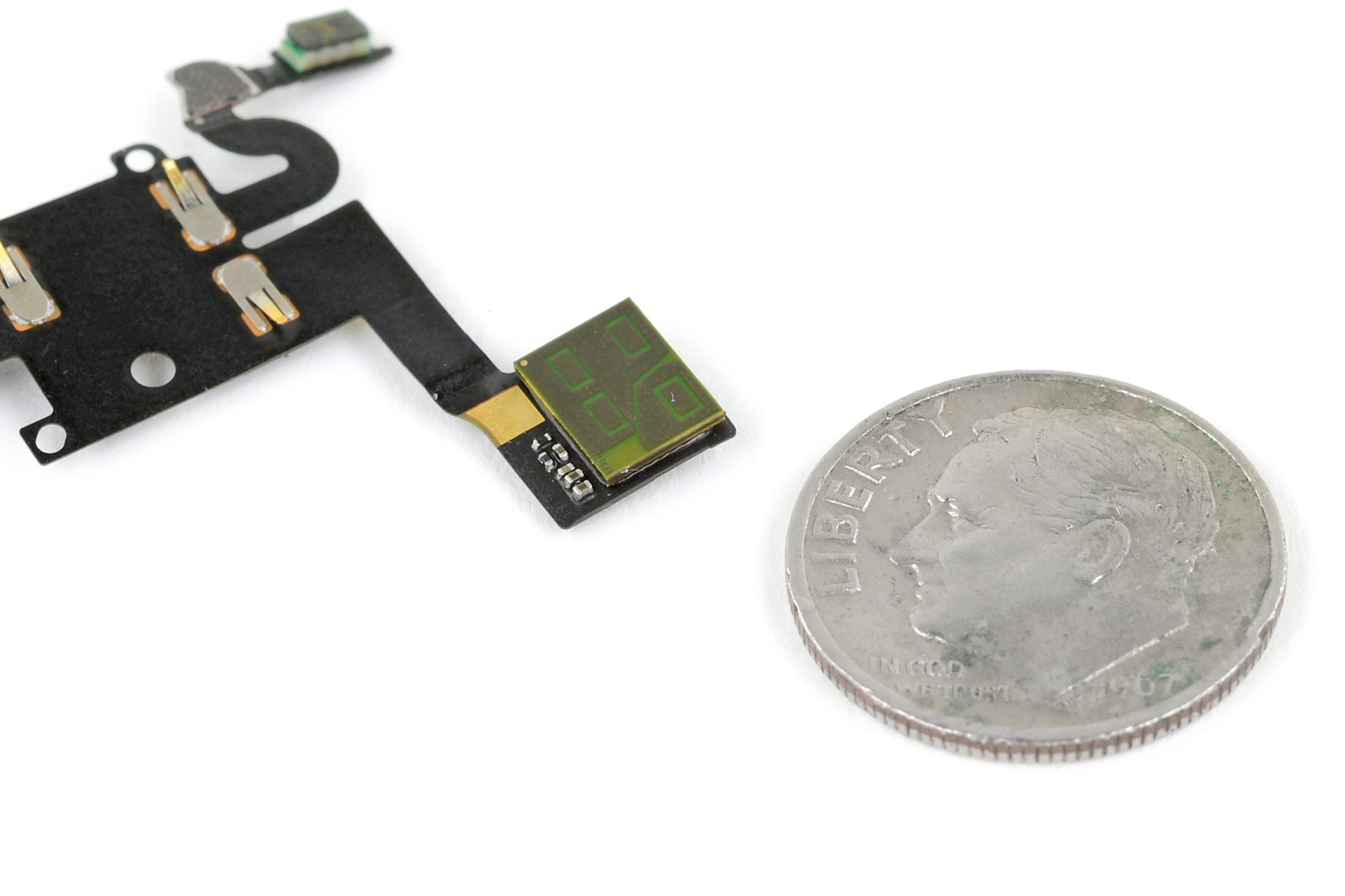 The Pixel 4's Soli sensor next to a US dime for size comparison