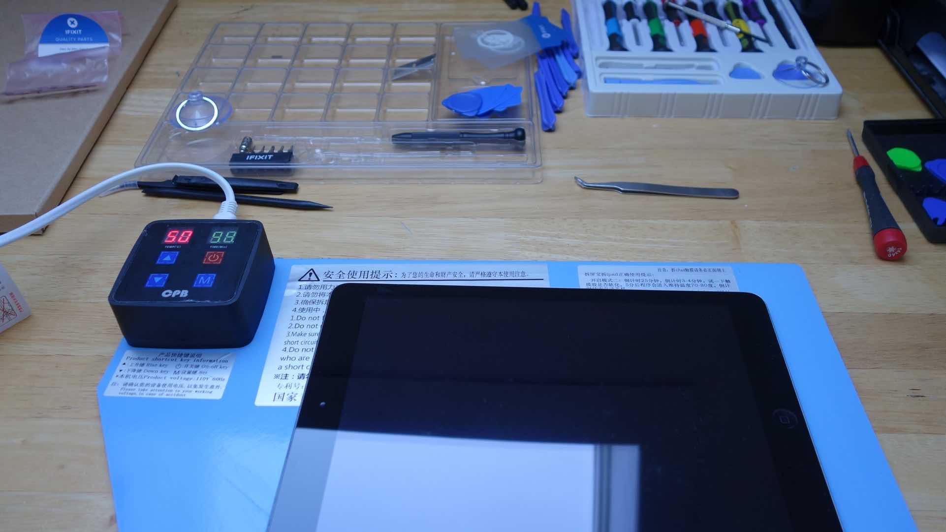 iPad undergoing repair at an independent shop
