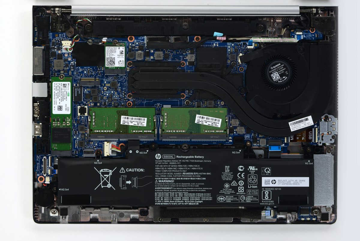 The internals of an HP Elitebook 840 G6 laptop, with removable storage, RAM, and Wi-Fi modules.