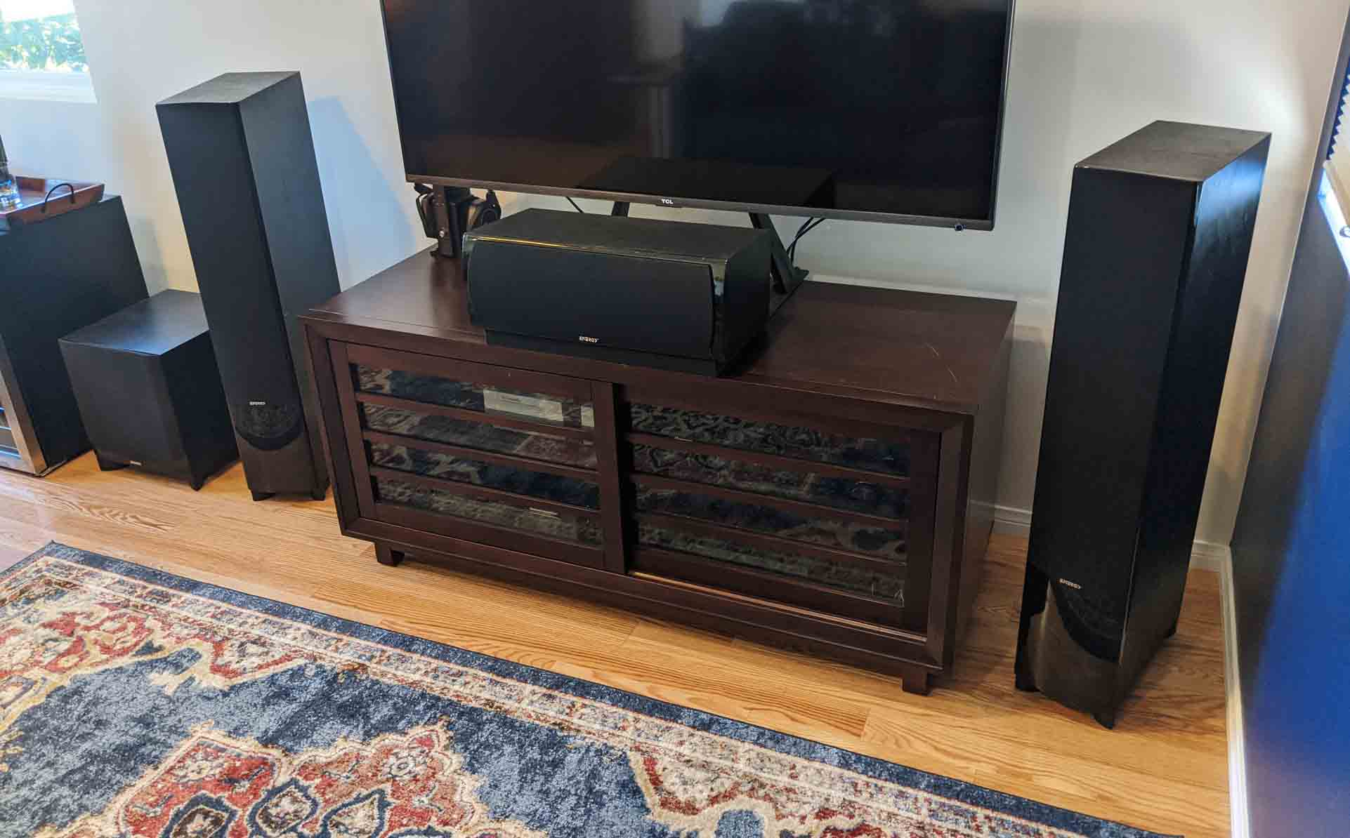 A set of speakers set up in a home theater setting.
