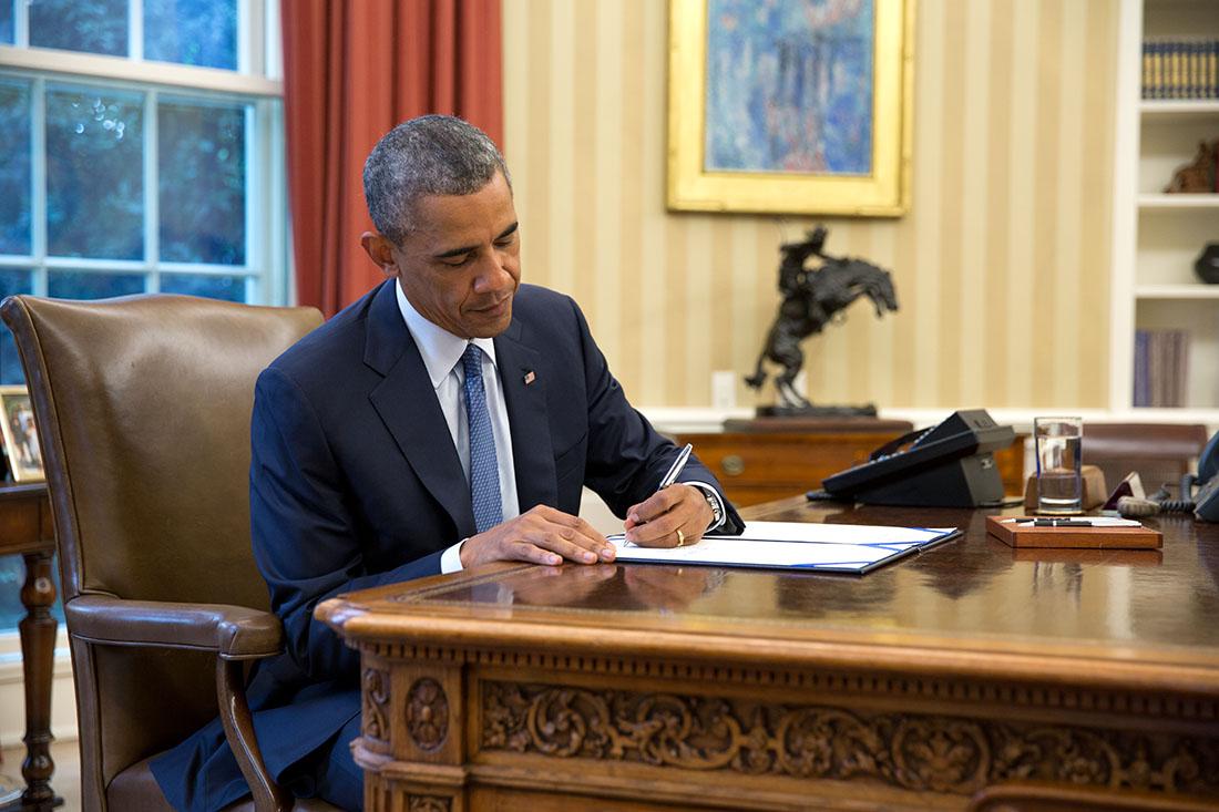 President Obama signing cellphone unlocking legislation into law.