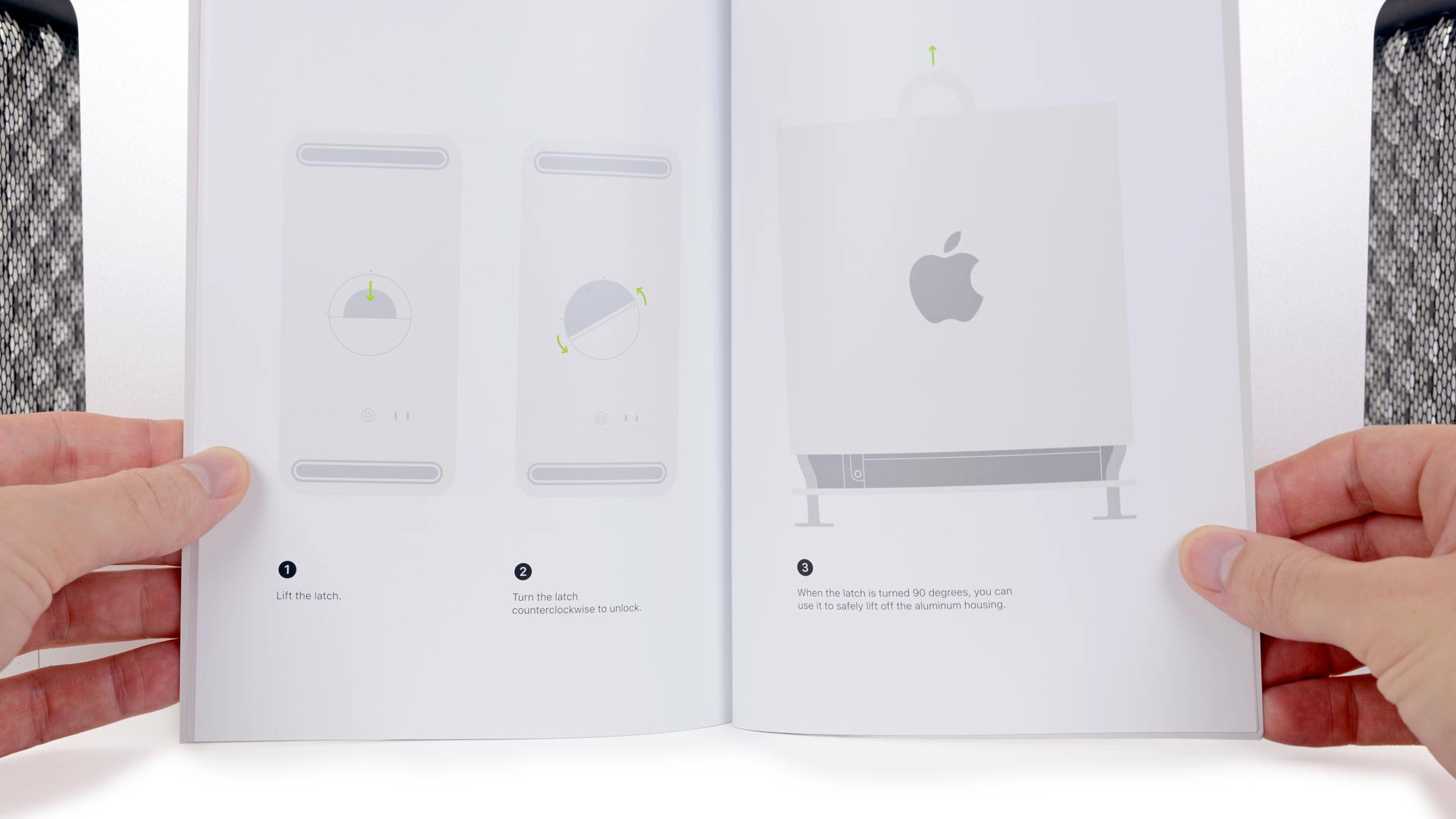 Image of the Mac Pro service manual, in front of two Mac Pro components.