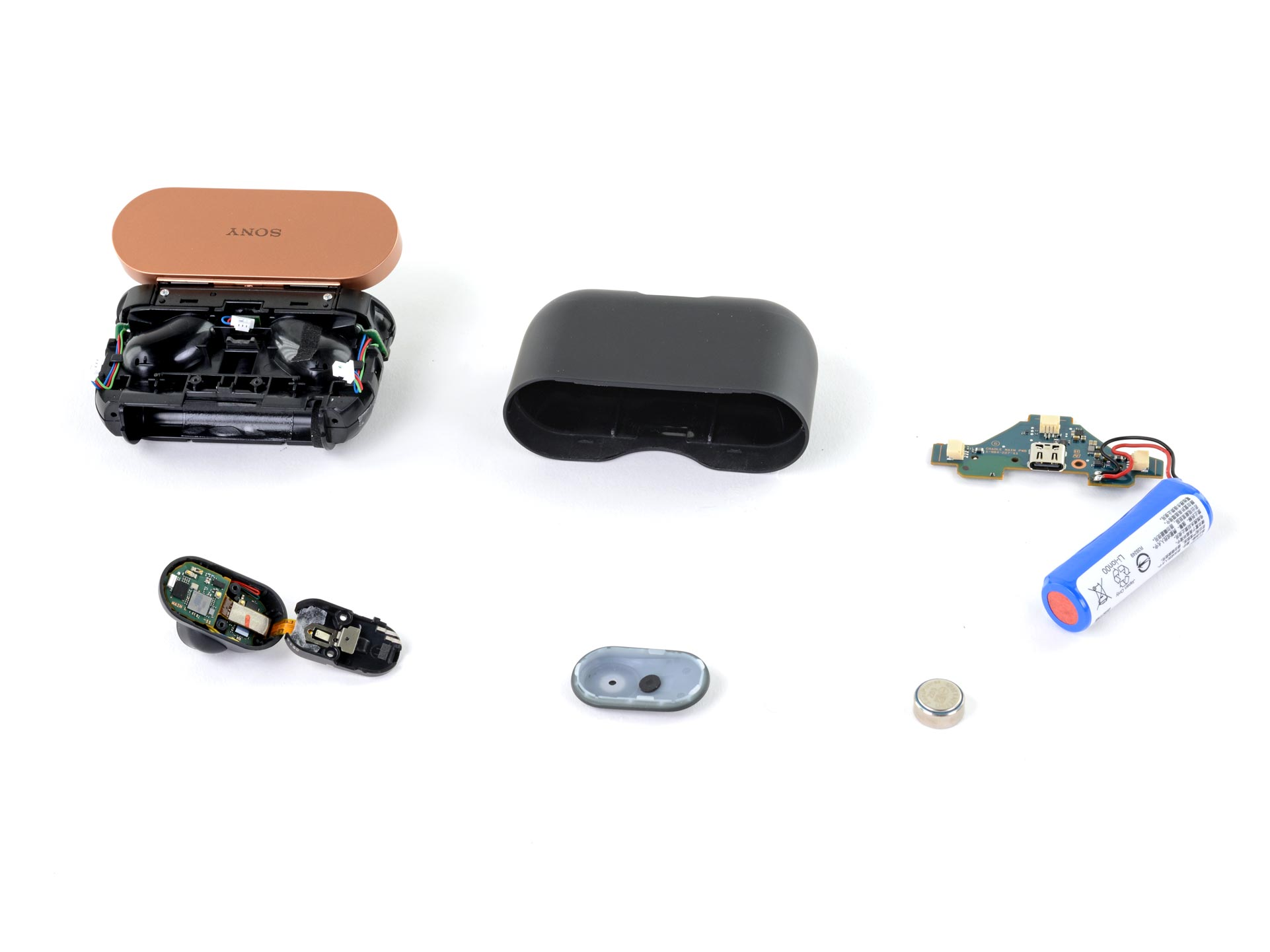 Layout shot of all the pieces of the Sony WF-1000MX3 charging case and earbud