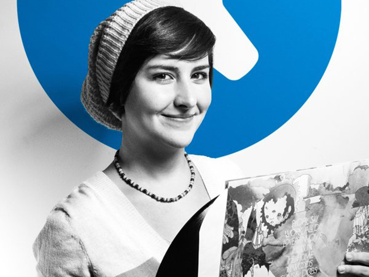 Kristen holding a vinyl in front of the iFixit logo