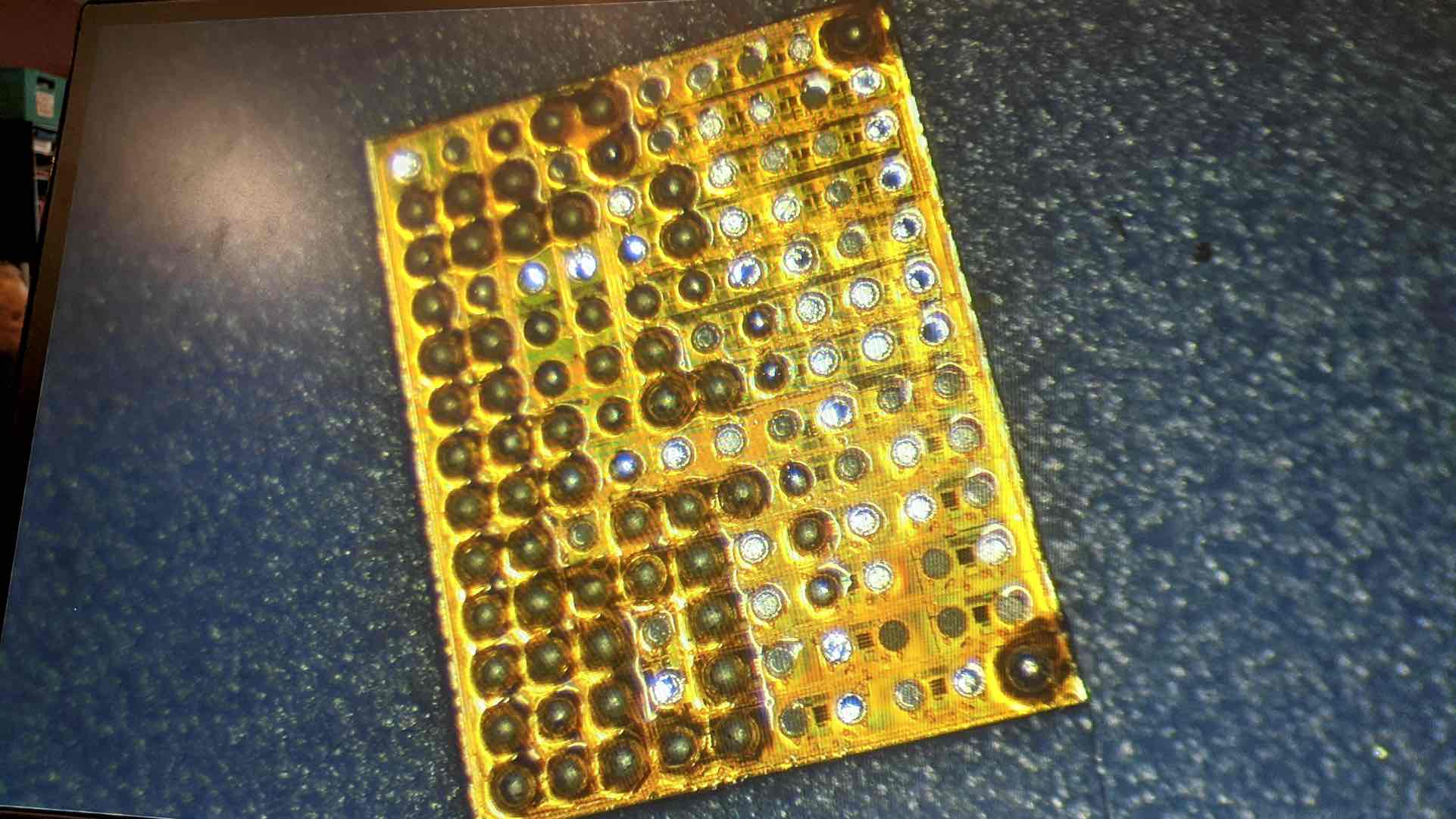 Backside of a chip removed from an iPhone board.