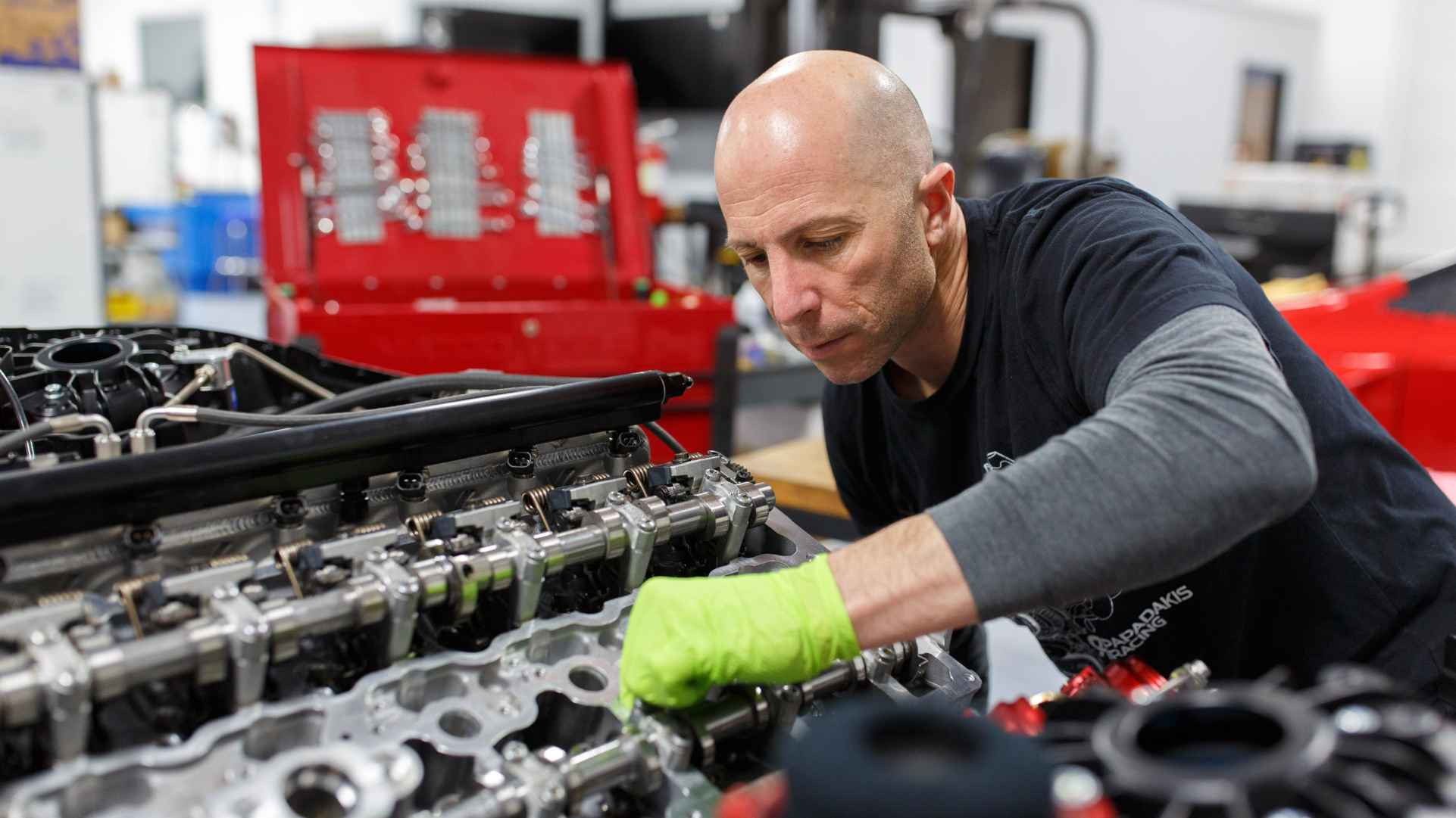 Stephan Papadakis of Papadakis Racing, working on an engine
