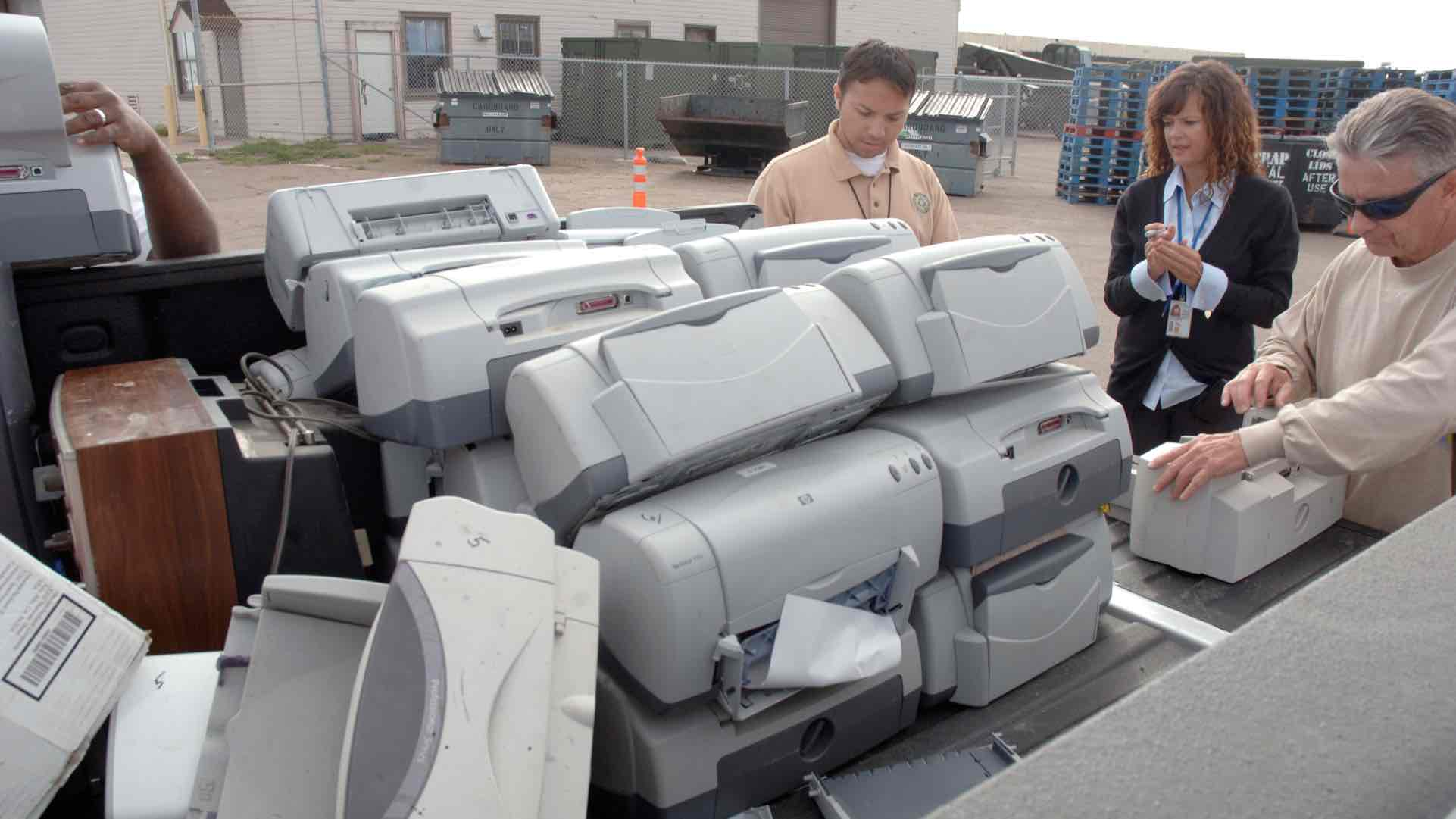 Pile of printers at an e-waste collection event