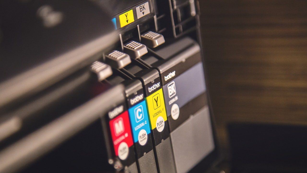 Printer ink cartridges (M,C,Y,BK) in a printer.