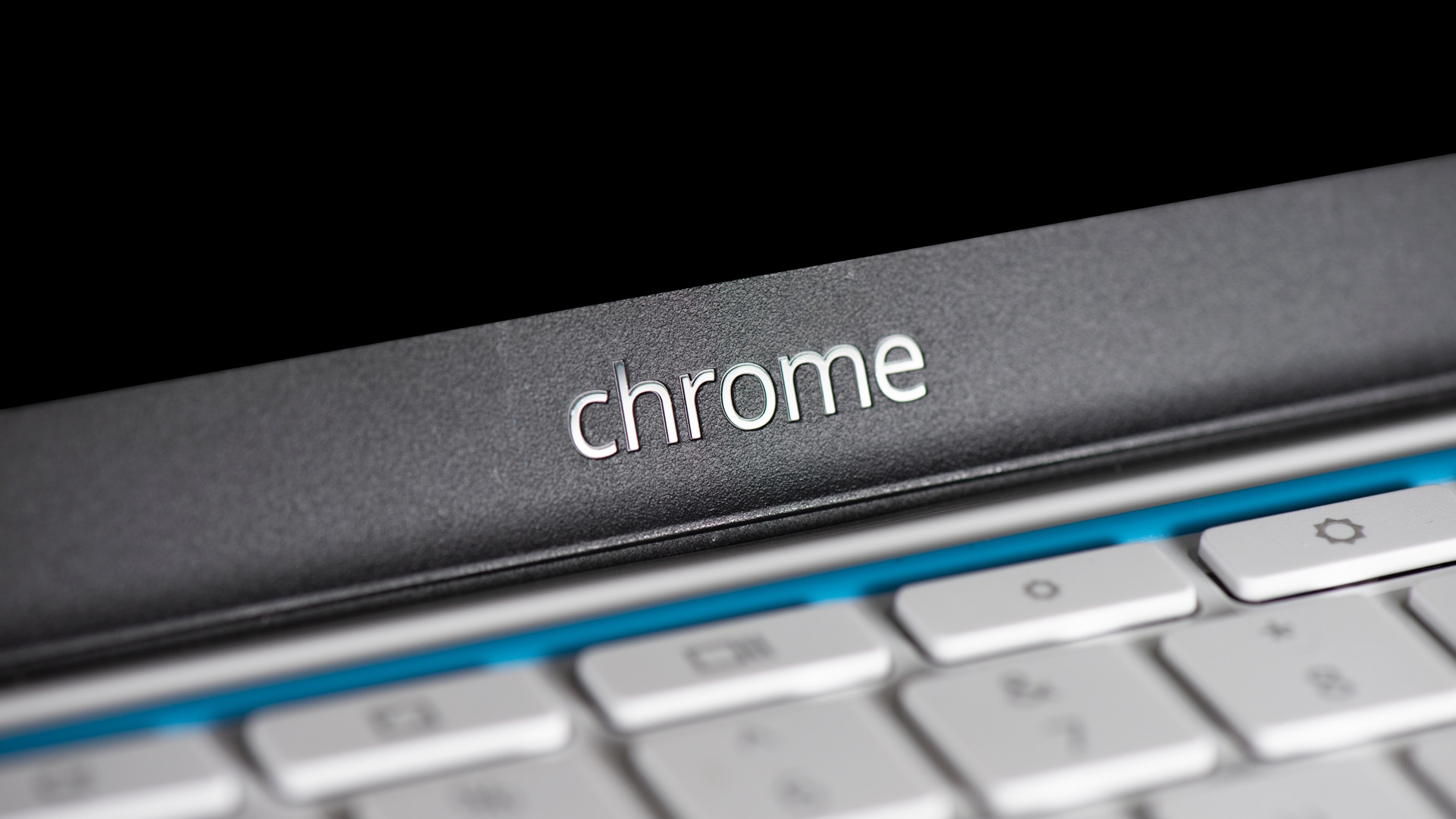 "Chromebook keyboard and display, with ""Chrome"" embossed on bezel"