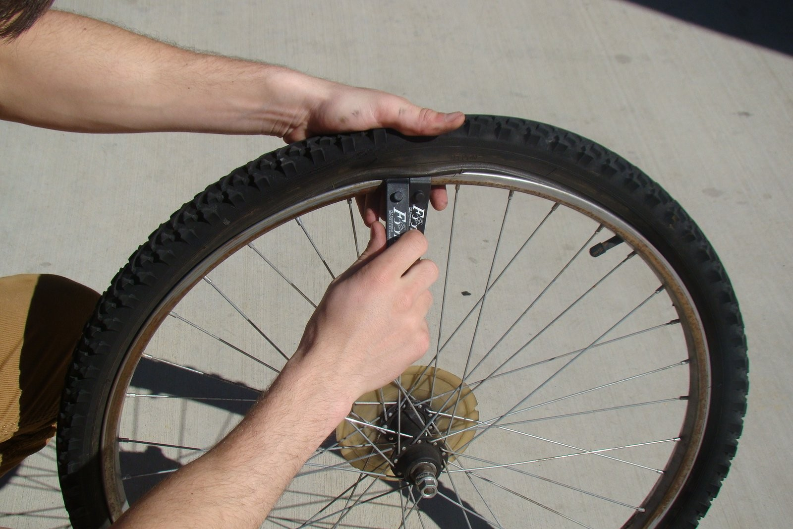 Bike tire being removed from a rim.