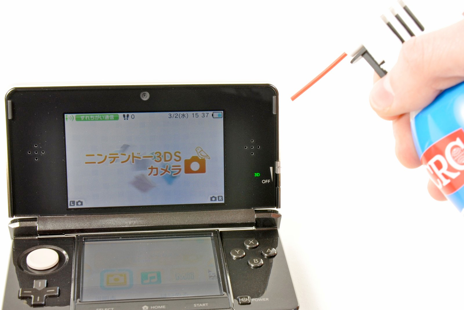 Nintendo 3DS being blasted with compressed air