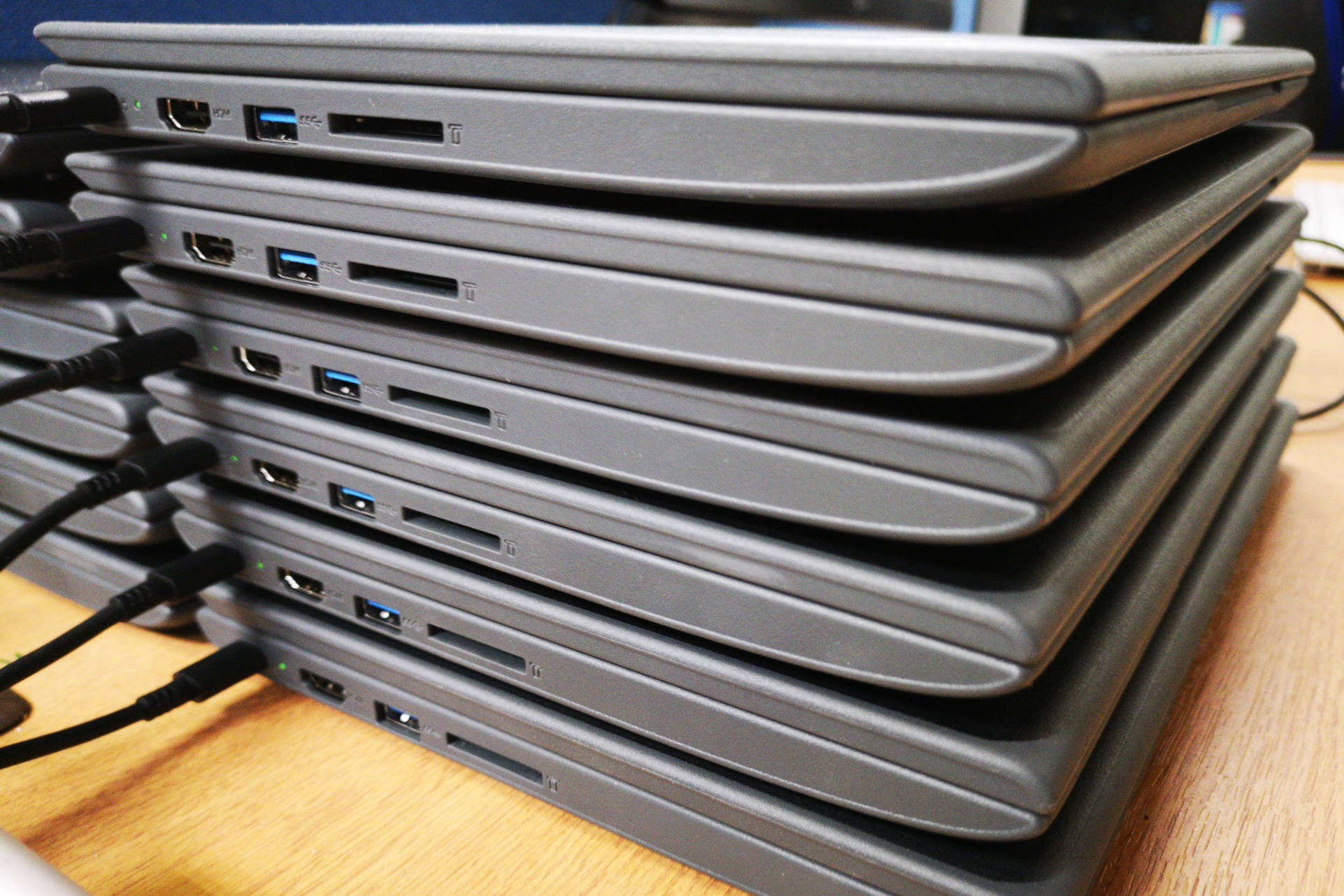 Chromebooks, stacked vertically