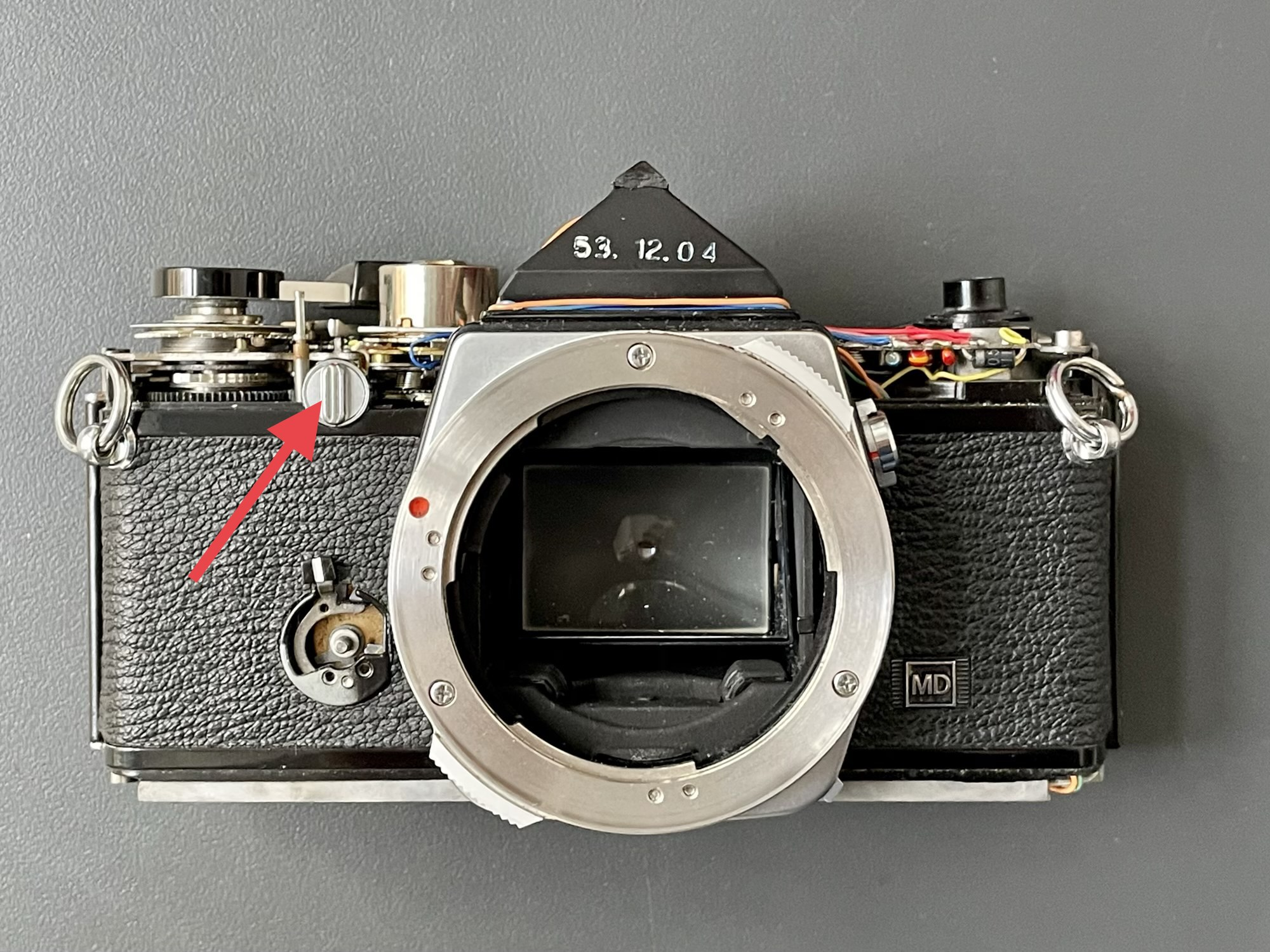 Olympus OM-2n front, with rewind release button pointed out
