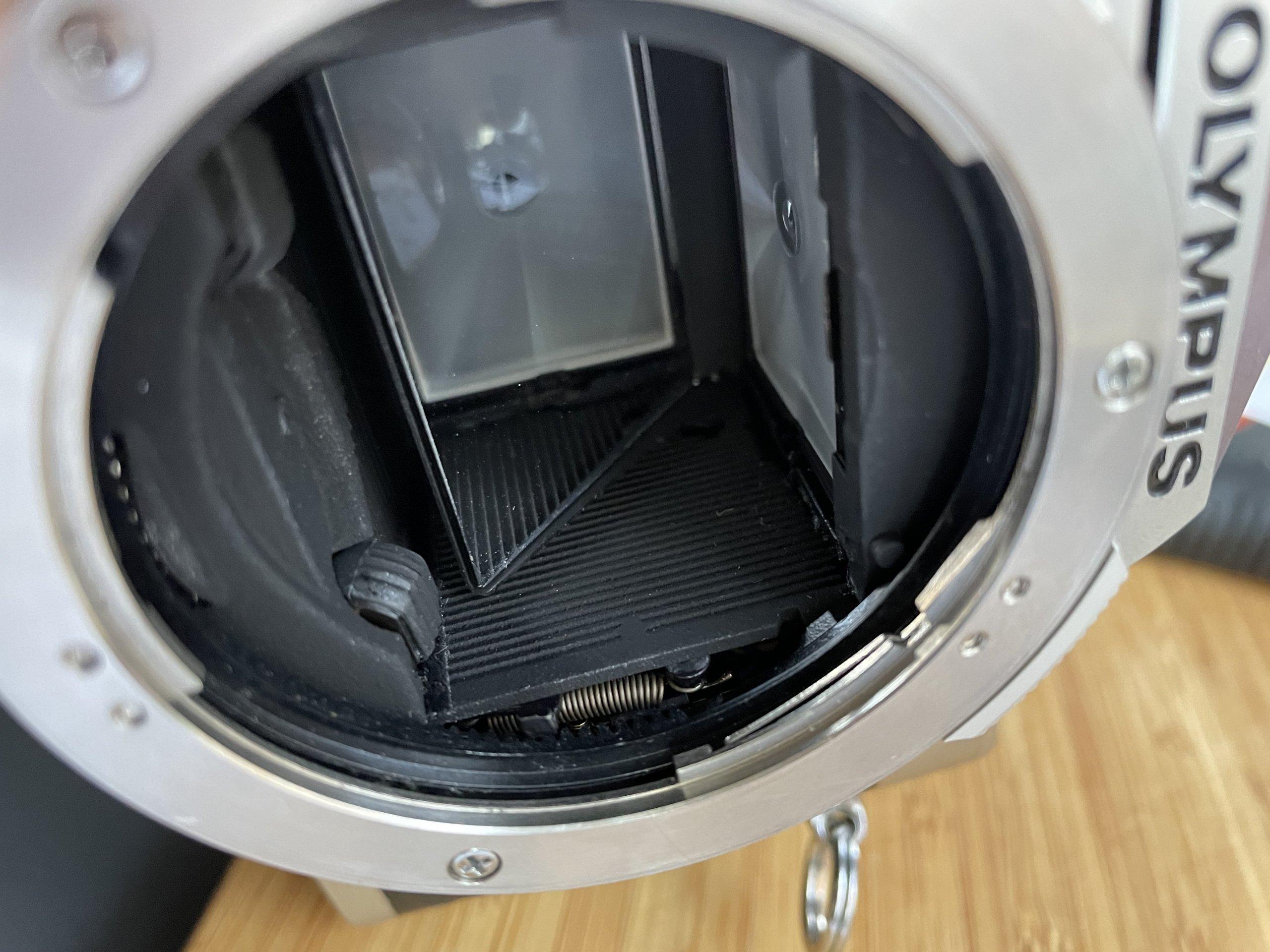 Inside the Olympus OM-2n camera's mirror mechanism.