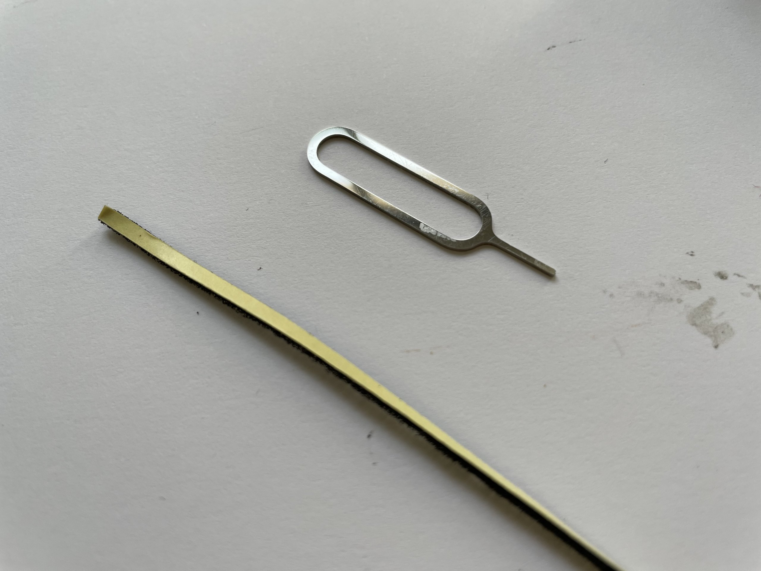 Thin foam strip and a SIM-eject tool