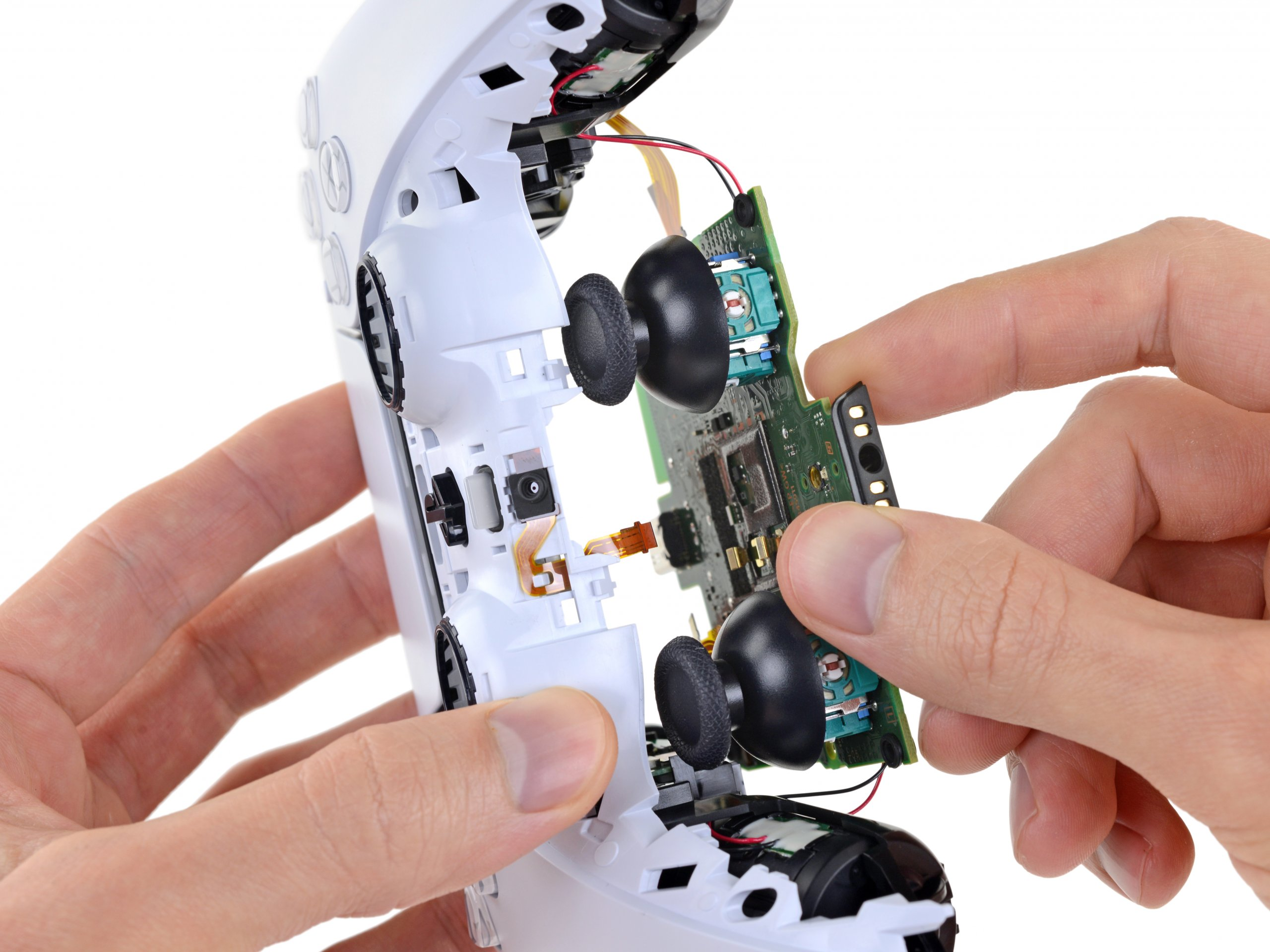 Opening a PS5 controller and removing main board.