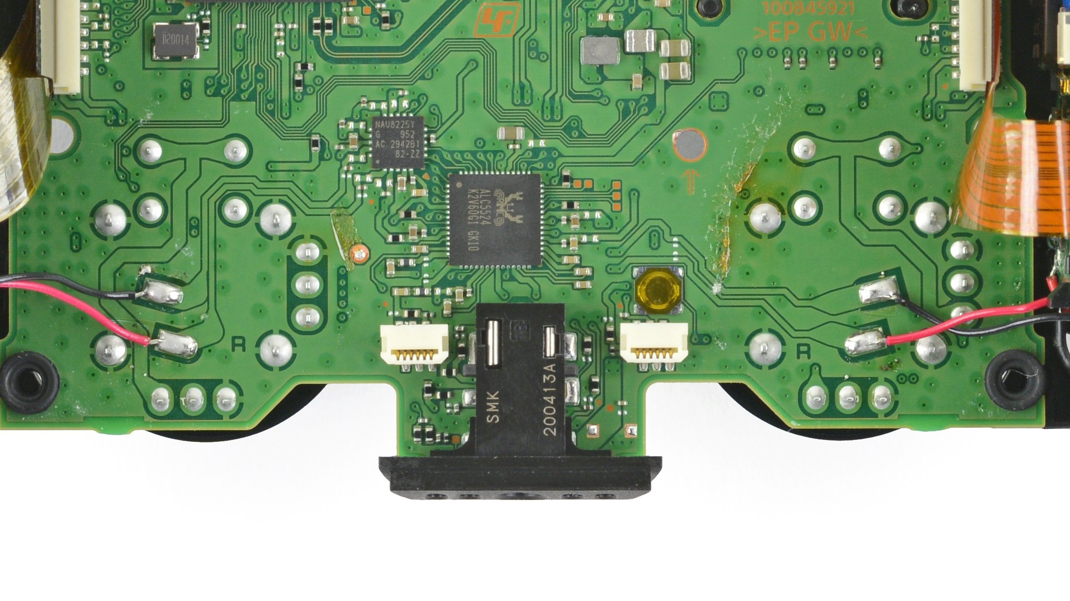 View of the backside of a PS5 controller, with board exposed.