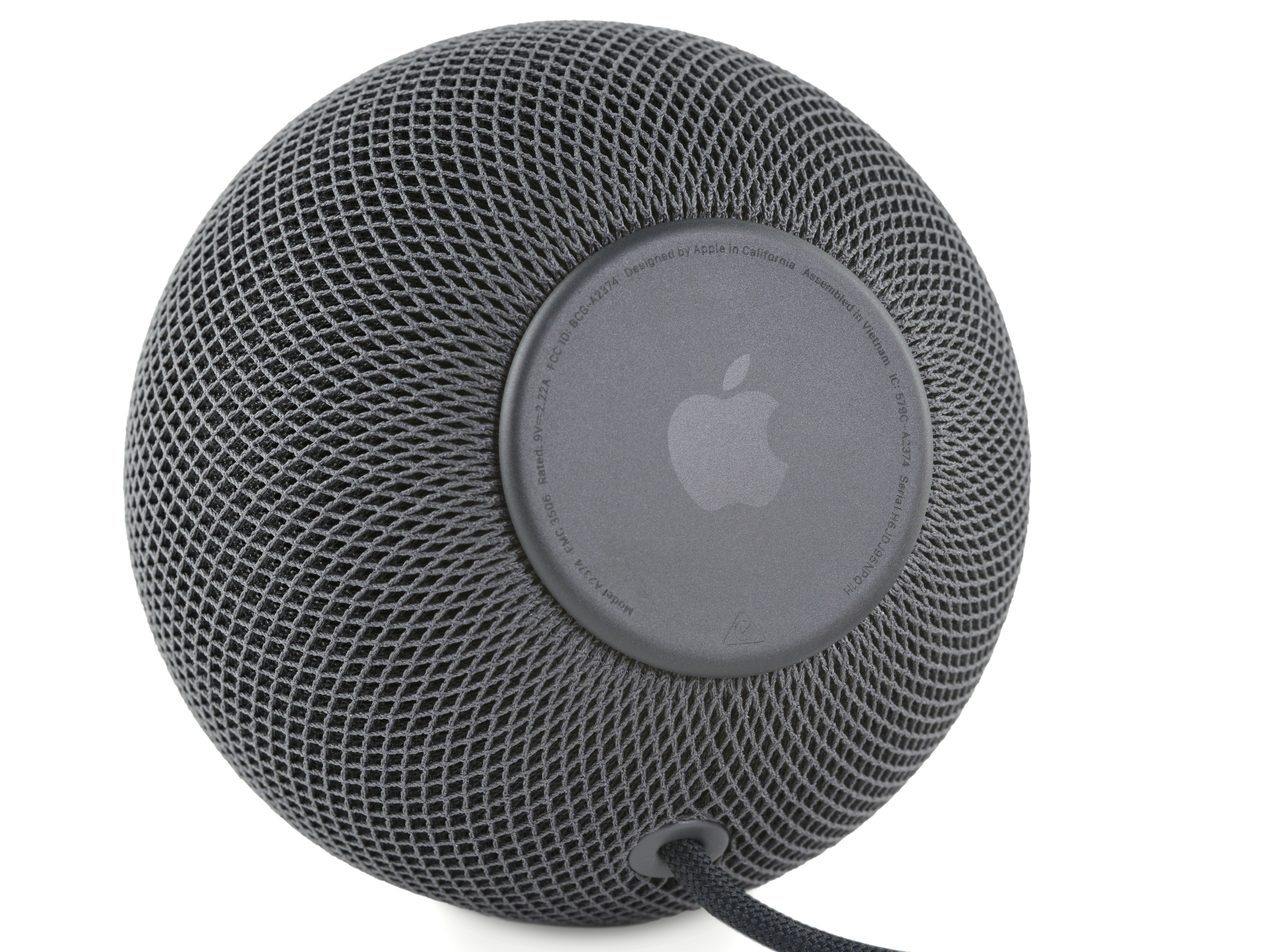 The bottom of the HomePod Mini, with its Apple-branded rubber foot..