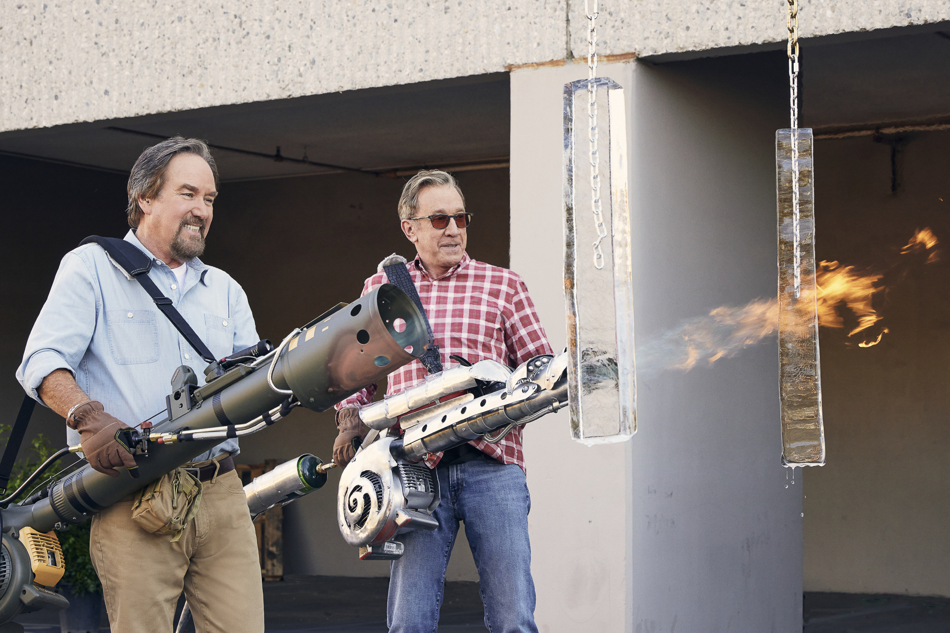 Tim Allen and Richard Karn test flamethrowers on the History show Assembly Required.