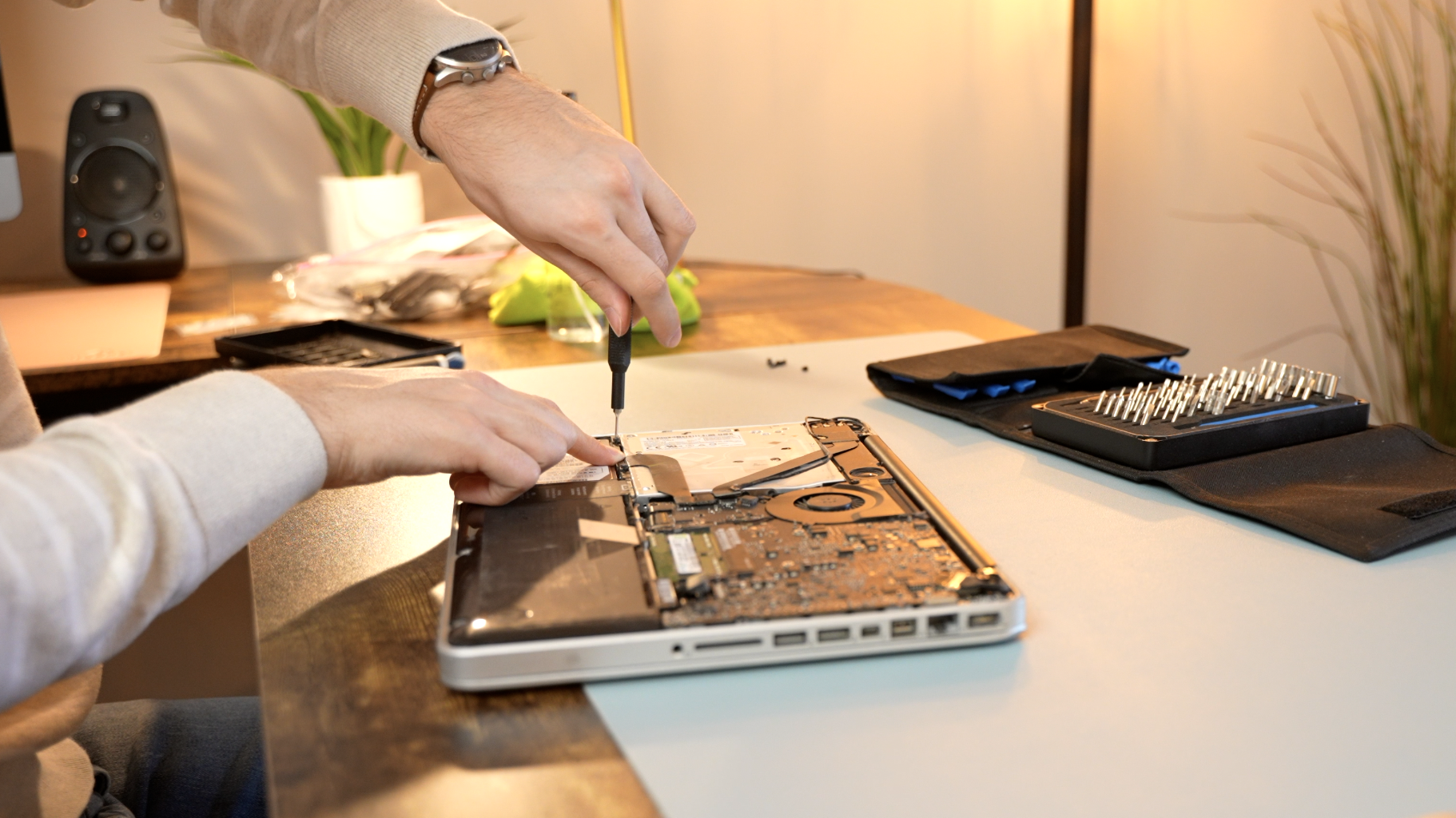 Using a screwdriver on a disassembled MacBook