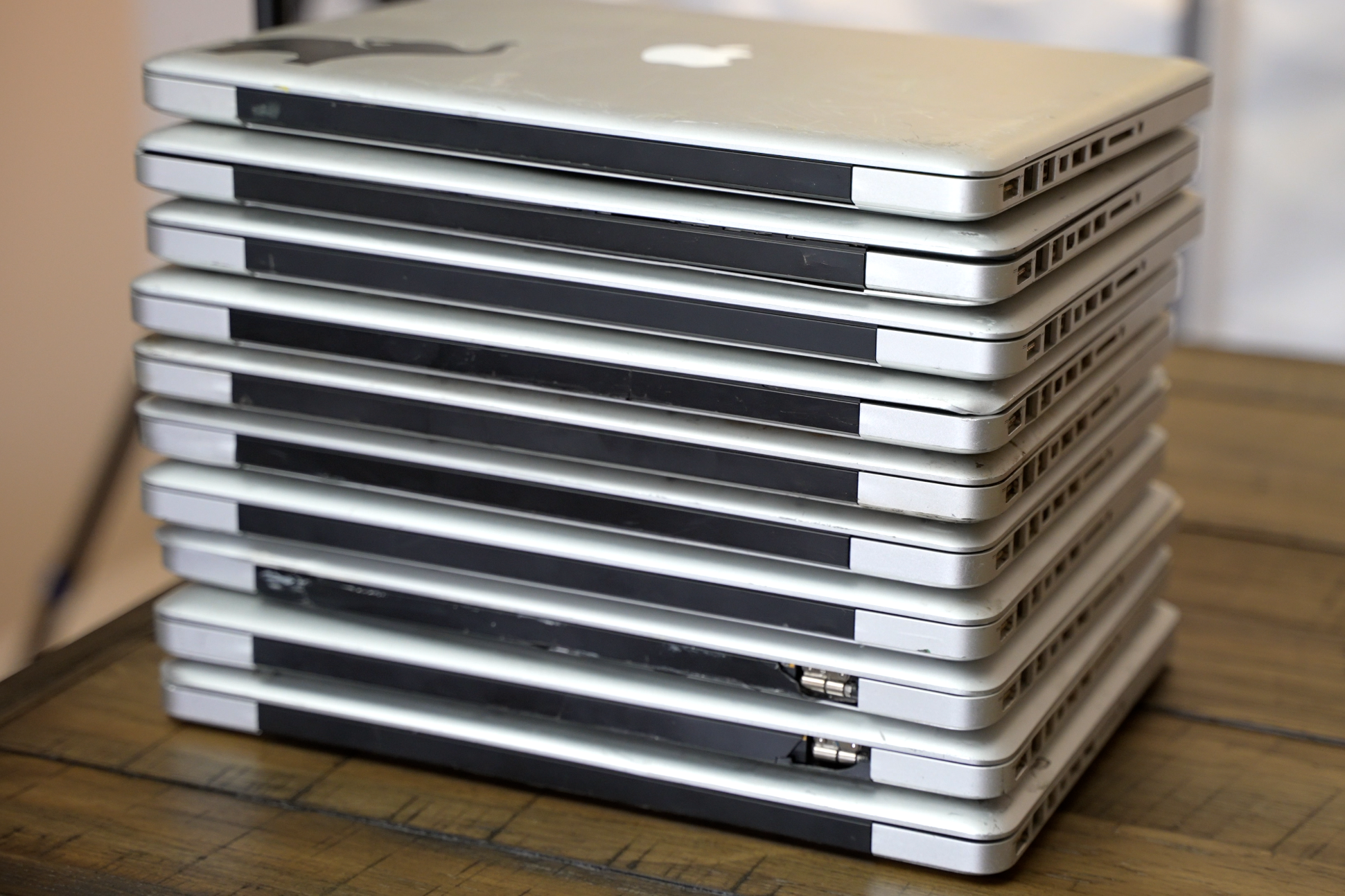 Stack of MacBooks Luke Miani attempted to repair