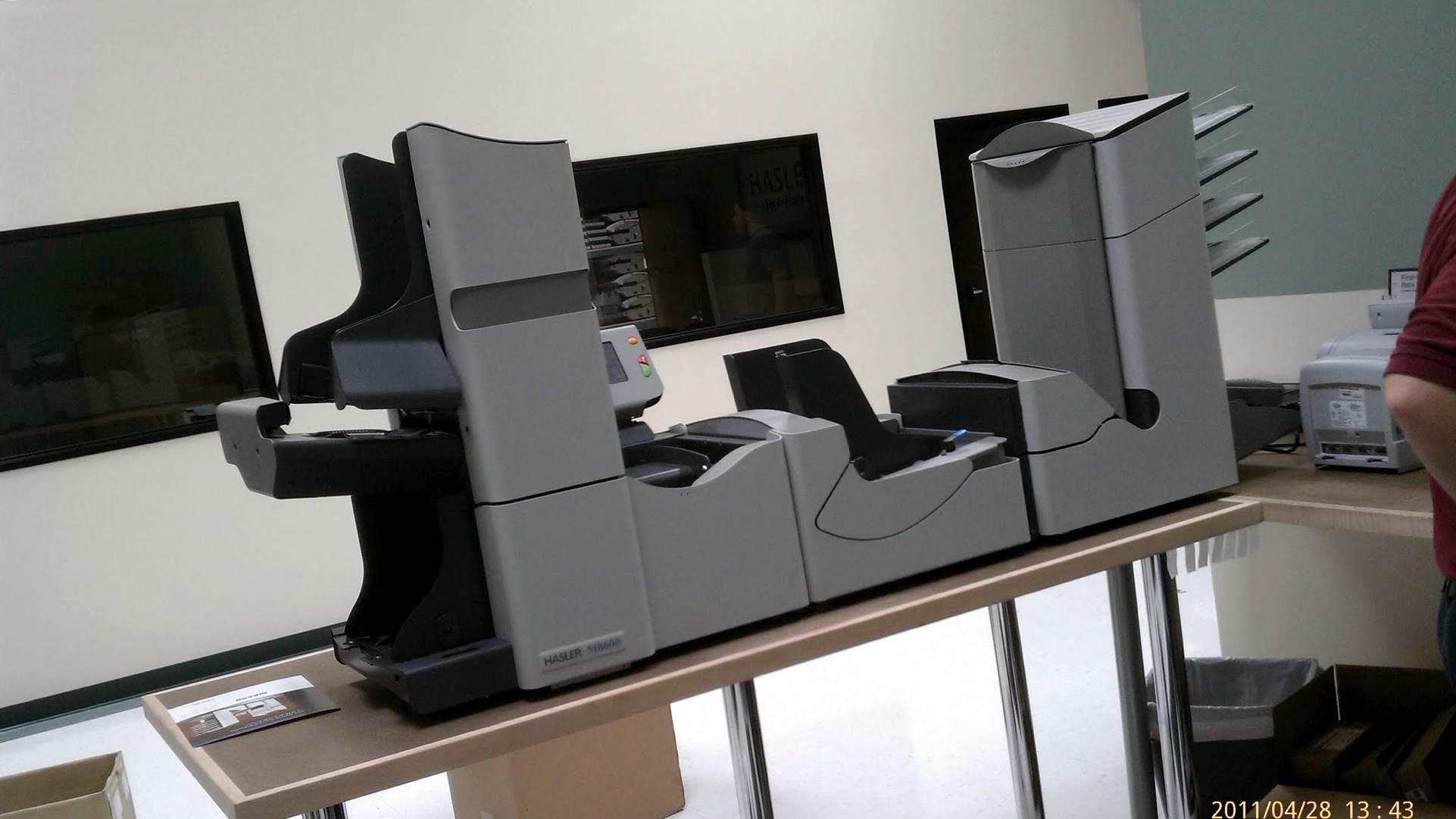 Large folder/sorter mailing machine.