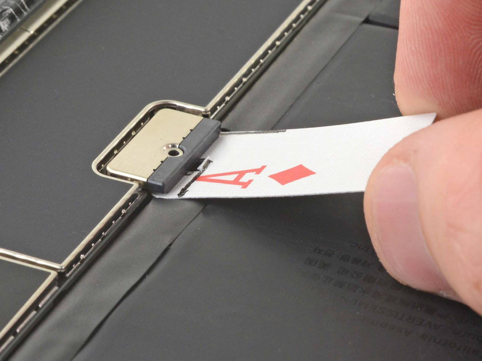 Sliding playing card cut-out under iPad battery connector